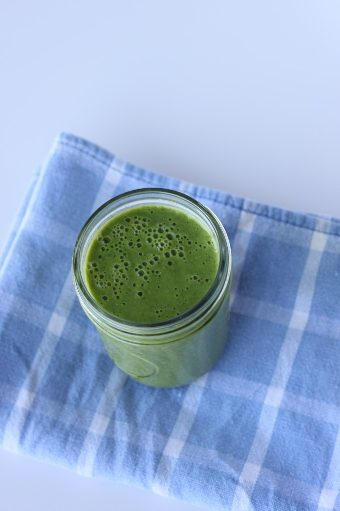 This energizing Green Smoothie combines spinach & kale with frozen banana and mango + a hint of ginger.  TheCornerKitchenBlog.com