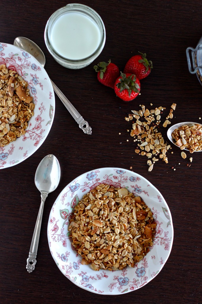 Maple Quinoa Granola is a delicious gluten free granola mixed with whole oats, crunchy quinoa, nuts & coconut, and naturally sweetened with pure maple syrup | TheCornerKitchenBlog.com #granola #quinoa