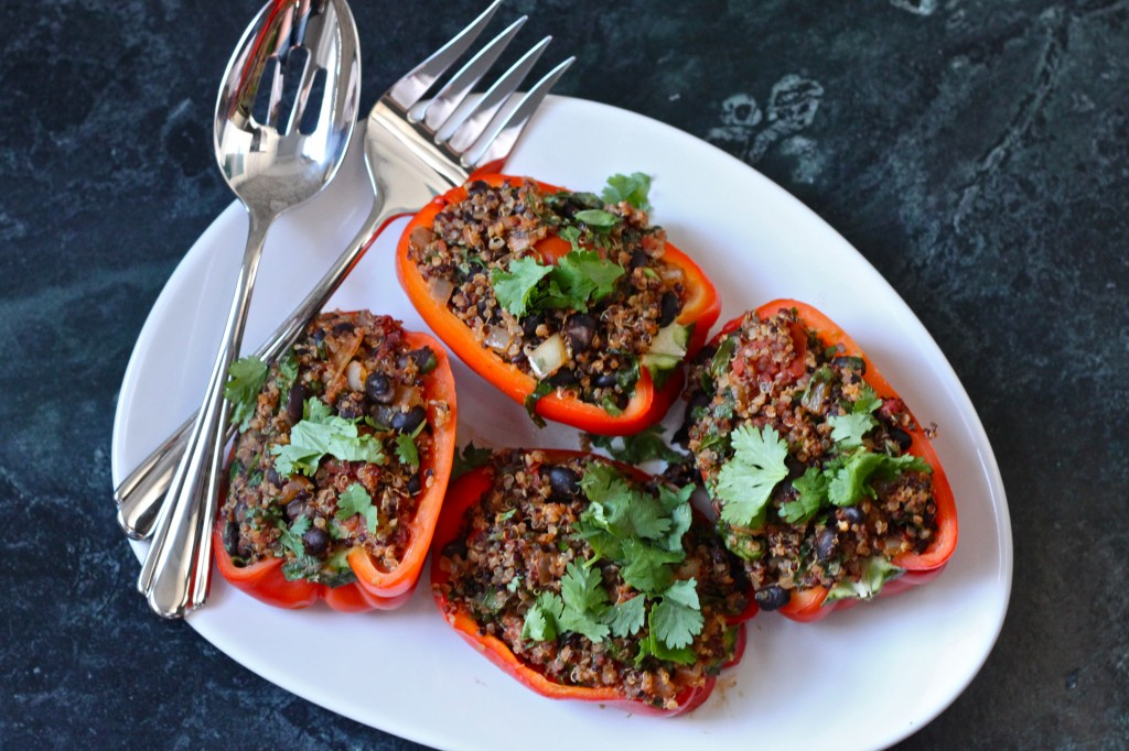 "Get a ""meaty"" meatless dinner on the table in 30 minutes with Vegan Quinoa Stuffed Peppers! TheCornerKitchenBlog.com"