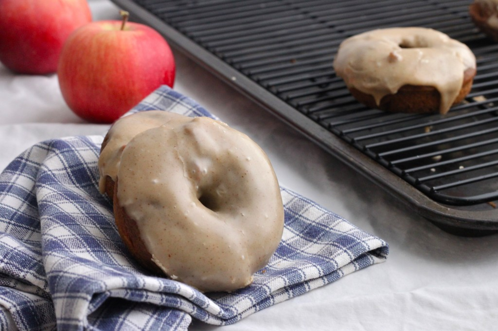 These perfect-for-fall Baked Apple Butter Doughnuts are spiced with cardamom and topped with brown butter glaze. | TheCornerKitchenBlog.com #apple #doughnuts
