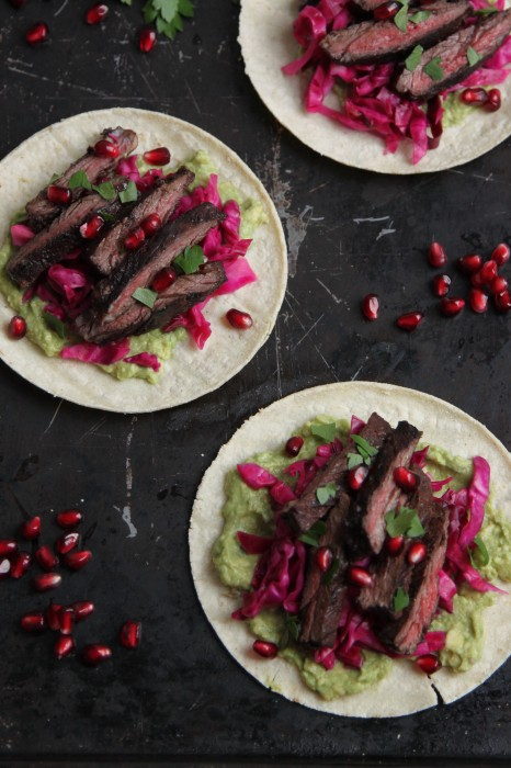 Pomegranate Glazed Skirt Steak Tacos with Pickled Red Cabbage and Spicy Guacamole
