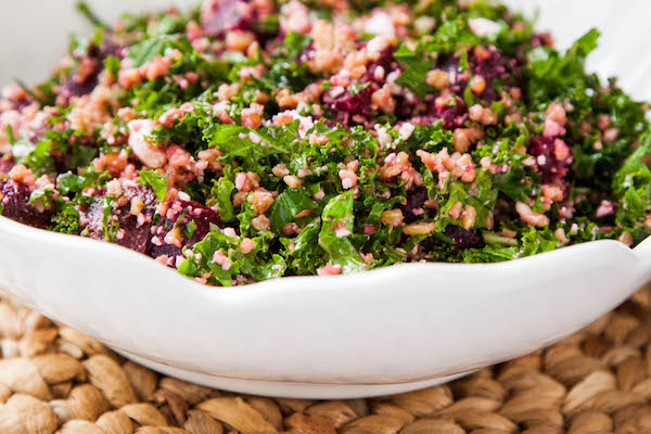 This super healthy salad combines freekeh, shredded kale, beets and feta cheese with a light lemon vinaigrette. It's perfect for a lunchtime! | TheCornerKitchenBlog.com #freekeh #kale