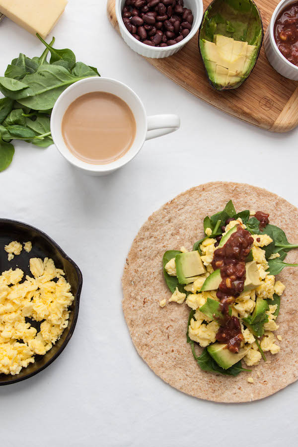 This healthy 5-Minute Breakfast Burrito filled with scrambled eggs, spinach, black beans and avocado is a quick and delicious start to the day | TheCornerKitchenBlog.com #breakfast #burrito #healthy #avocado #eggs