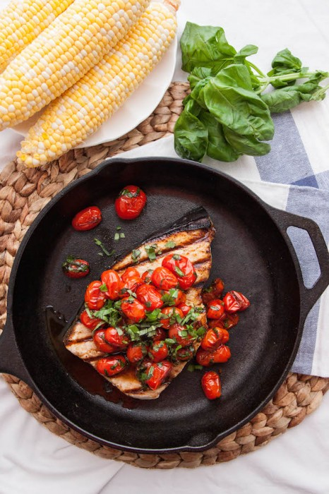 Just 5 ingredients and 20 minutes stand between you and Grilled Swordfish with Tomatoes and Basil - it's an easy weeknight meal to bust you out of your dinner rut!