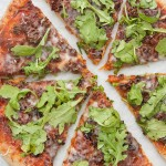 Caramelized Onion and Sausage Pizza with Arugula
